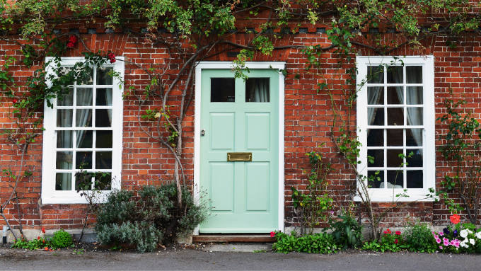 Front Door of an Attractive Old Red Brick Town House With Traditional Windows
