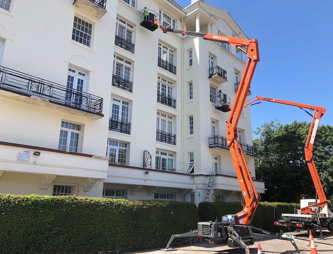 Property maintenance on white building